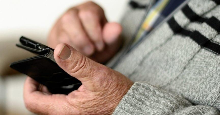 senior citizen on smartphone
