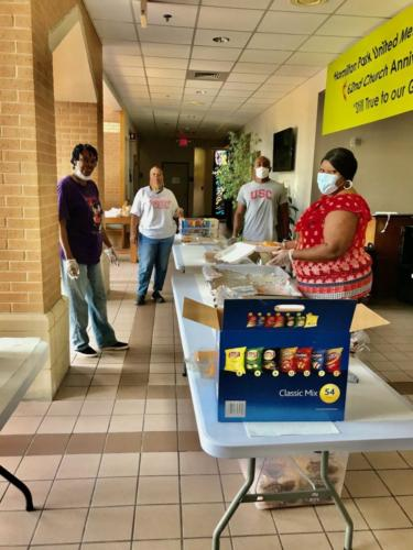 Volunteers practice CDC health guidelines with masks, gloves and social distancing as they prepare meals for the neighborhood feeding program at Hamilton Park UMC in Dallas, TX. The church started its feeding program March 23, 2020, to aid its neighbors who needed food during the coronavirus pandemic.
